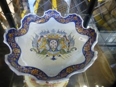 A French Faience Armorial plate having shaped rim, possibly 18th Century 27.5cm