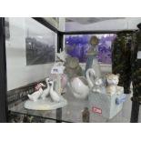 A selection of Nao figures, cats, birds, elephants, etc