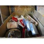 A box of china mugs, glasses, old games and a boxed cutlery set