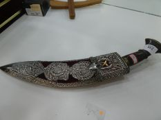 A white metal Kukri knife with ornate pierced and decorative design