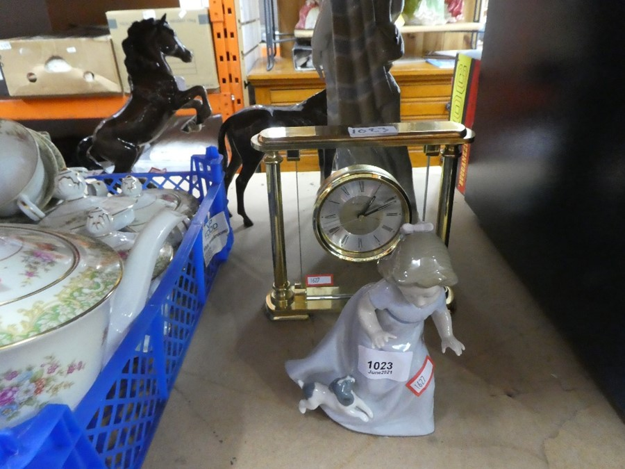 Nao figure of child and puppy and a mantle clock