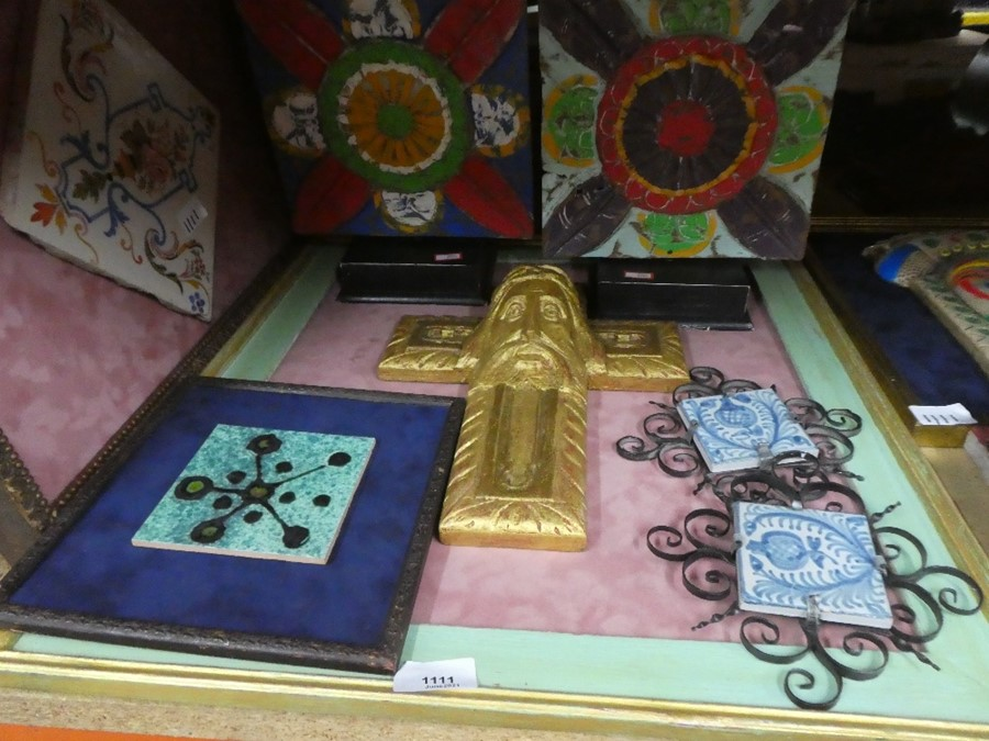 Various framed plaques and tiles some depicting religious icons
