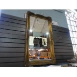 A large gilt framed mirror