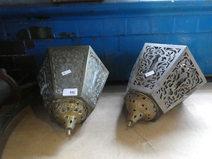 A pair of pierced brass Islamic style ceiling lamps