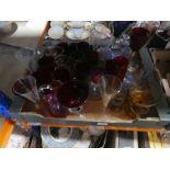 A box of coloured glassware, 4 decanters and a box of glassware