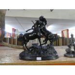 Cast mixed alloy figure depicting horses