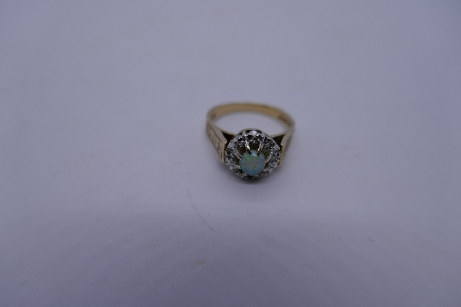 9ct yellow gold cluster ring with central opal surrounded diamond chips, Size K, 3.1g, marked 375