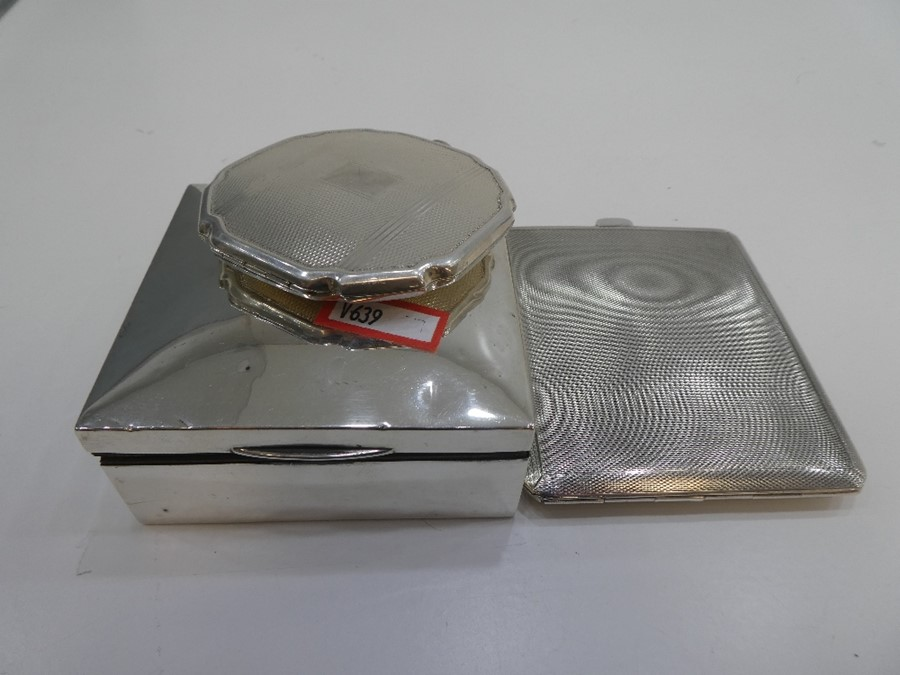 A silver compact of engine turned design along with a silver engine turned cigarette case with gilt