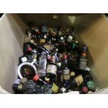 A box full of miniature spirits, including Scotch, etc