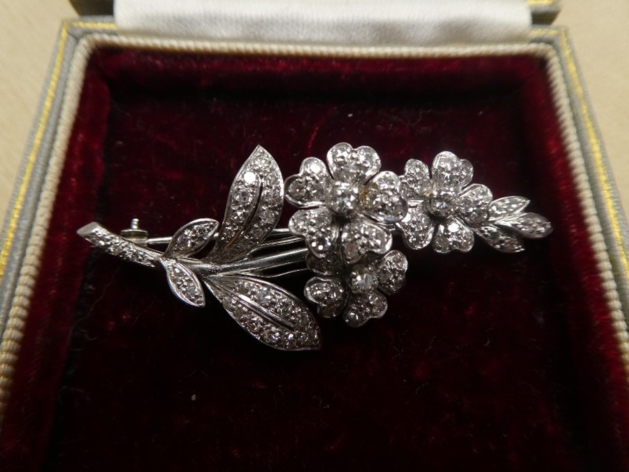 White metal, possibly 18ct white gold, floral design brooch inset with many diamonds, approx 5.5cm