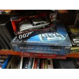 Selection of James Bond models including 1/18 DB5 and additional 007 base stations