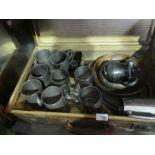 A vintage case of tankards, brass dish teapot, etc