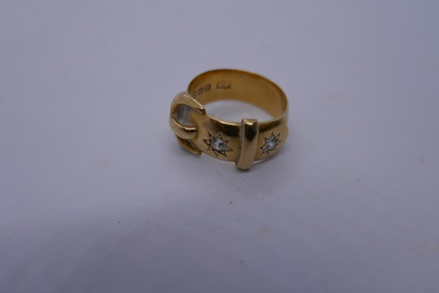 18ct yellow gold buckle ring inset with 2 sunburst diamonds, marked 18ct size N/o, 8.6g approx