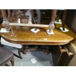 French walnut oval extending table with two leaves and 6 bar back mahogany dining chairs with red an