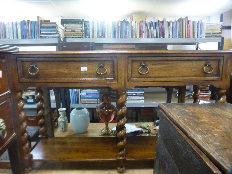 Reproduction oak side table having 2 drawers with shelf below and barley twist legs 156cm wide