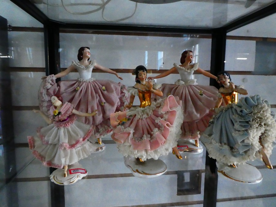 Selection of Capodimonte figurines wearing lace effect costumes