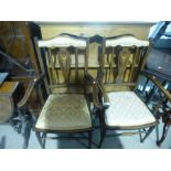 Pair of mahogany dining chairs upholstered in gold fabric with inlaid decoration