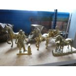 A selection of heavy style brass ornaments to include horse and carts, Blacksmith, etc