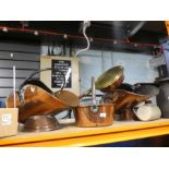 Four copper items to include two coal scuttles, cooking pot, bed pan and stone hot water bottle
