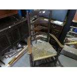 Large wooden carver chair with woven seat
