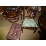 Red leather button back footstool and a single chair with green upholstered seat