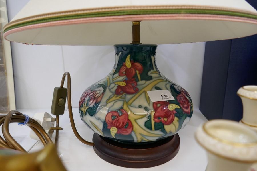 A Moorcroft squat lamp decorated flowers