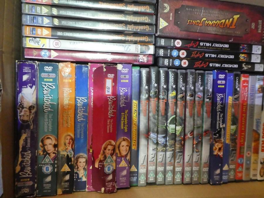 Selection of mostly box set DVDs including Star Wars, Thunderbirds, John Wayne, etc