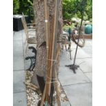 A selection of long handled garden tools, pitchfork, hoe, etc