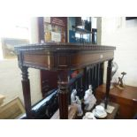 A Victorian rosewood foldover card table on fluted legs, 92cms