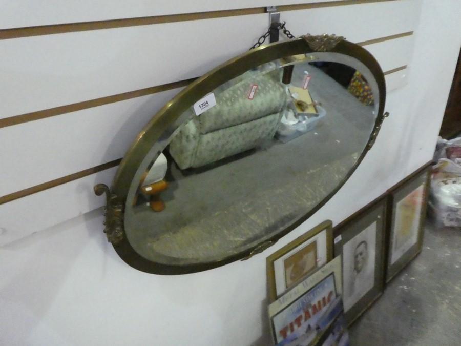 Oval brass mantle mirror