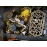 A box of brass items to include collector's spoons, pot stand, kettle, lamp, etc