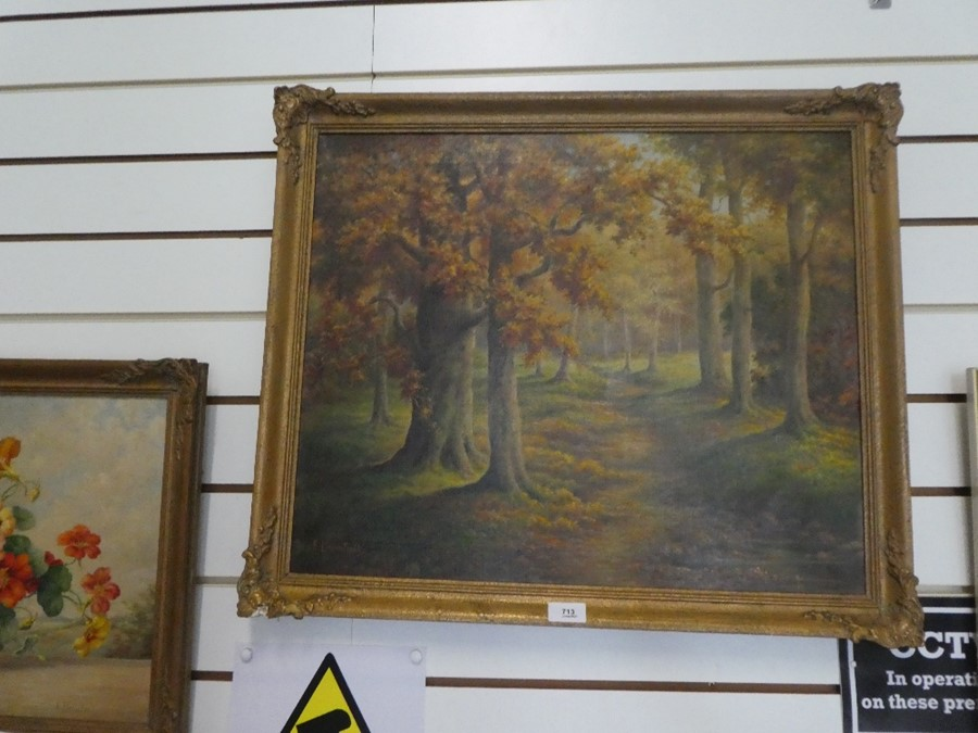E Bromhall: an oil of a vase of flowers and an oil of a woodland path. The largest 59.5 x 49.5cms