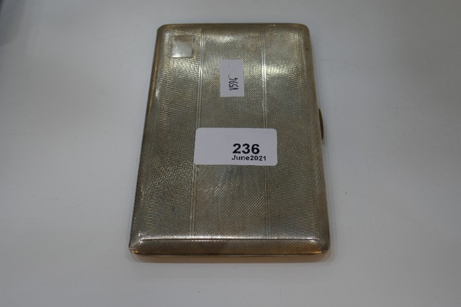 A large heavy silver cigarette case with gilt interior and engine turned exterior, Chester 1946, Don - Image 4 of 6