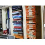 A selection of hard and paperback books on various subjects including Penguin, etc