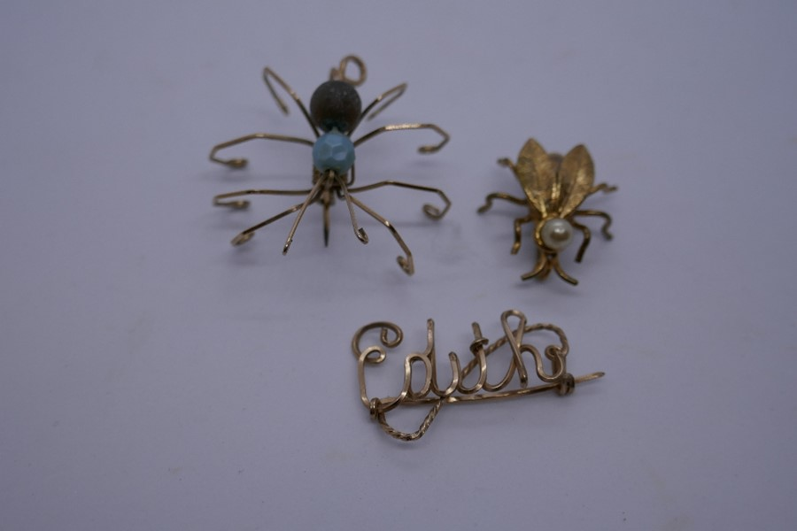 Yellow metal brooch in the form of a spider together with one of a fly with simulated pearl detail a