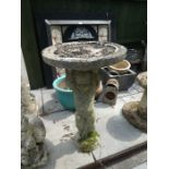 Stone effect bird bath with cupid design column and a selection of glazed pots and sundries