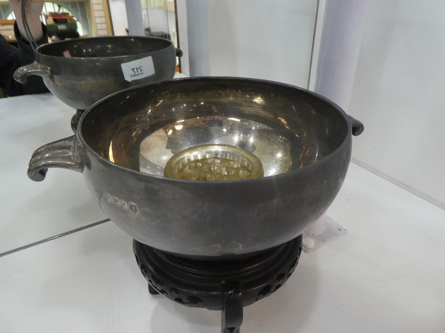 A very large, heavy silver two handled bowl on stand, hallmarked London 1935, Boodle and Dunthorne,