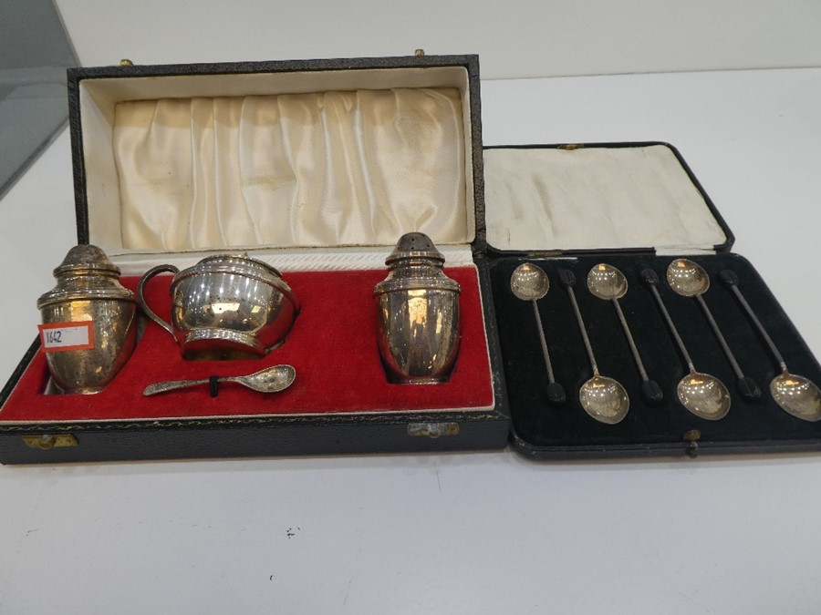 A silver lot comprising coffee spoons, hallmarked Sheffield 1932 Walker and Hall, silver salts, p