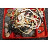Red fabric box containing various coins, costume jewellery and small tray of sliver and other costum