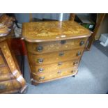 An antique Dutch marquetry bow fronted chest having 4 drawers