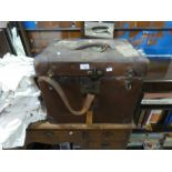 A chest containing vintage dolls and clothing, bags and vintage white jackets, etc