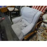 Fireside grey armchair on wooden feet