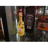 Two bottles of alcohol, including Jack Daniels and Lanson Champagne