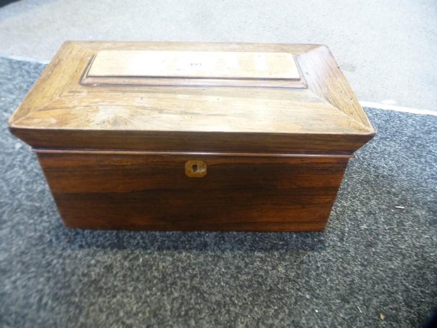 A Victorian rosewood tea caddy