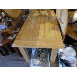 A pine rectangular Kitchen table