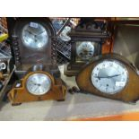Four different style wooden mantle clocks, one with ornate brass face AF