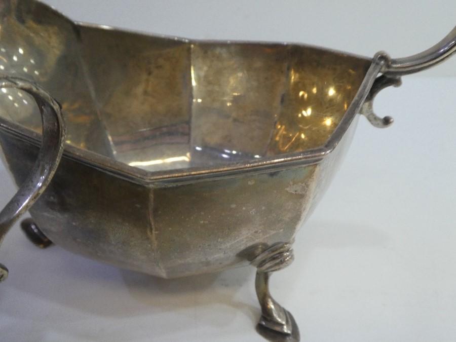A silver sauceboat hallmarked, Birmingham 1927 Adie Brothers Ltd, also a silver hallmarked sugar bow - Image 5 of 5