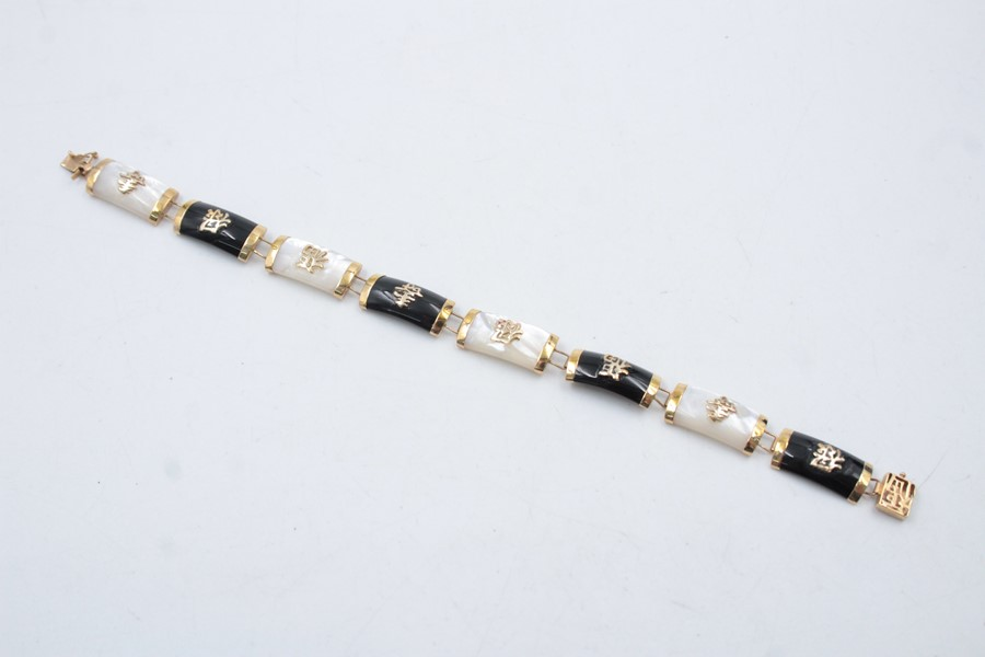 9ct gold onyx and mother of pearl set oriental bracelet 11.5g