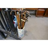 A quantity of walking sticks and similar, some silver decorated in an oriental stickstand