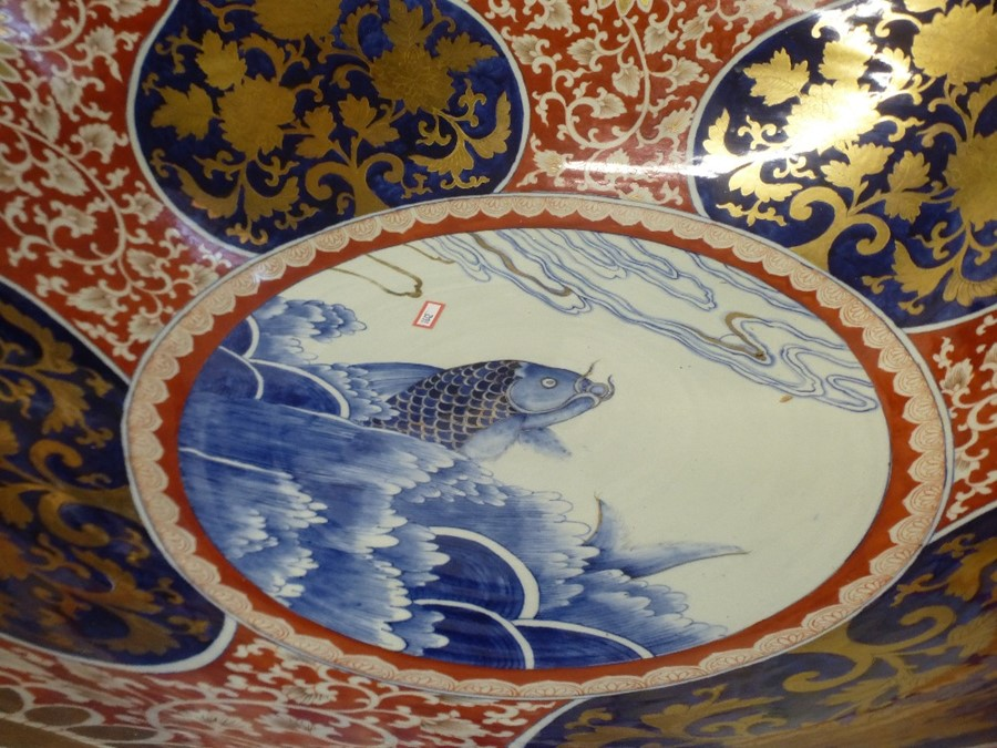 A 20th Century Chinese bowl, interior decorated with fish 68cm on wooden stand - Image 2 of 4